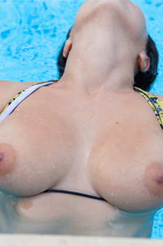 Busty Brunette Babe Removes Her Bikini In The Swimming Pool - Picture 4